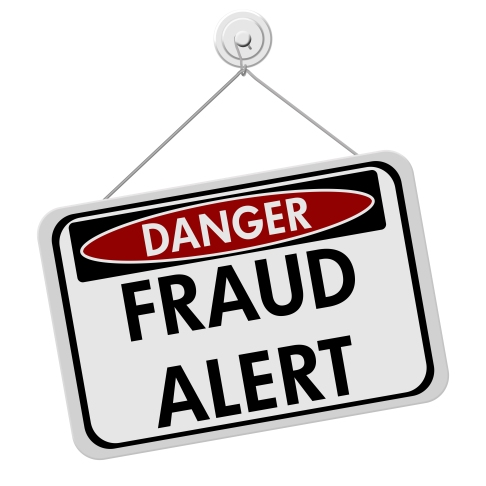 A red white and black sign with the word Scam Alert isolated on a white background Danger Fraud Alert